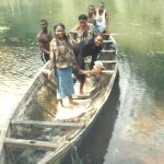 Tourists taking a Ride on the Azumiri Blue river