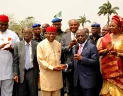 Gov. T.A Orji receiving the keys to the security vehicles presented by Diamond bANK