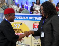 Gov. Theodore Orji of Abia state receiving an award as Prime ambassador of Health Care from Dr. Mrs. Maureen Igwe unbehalf of Nigeria Optometric Association during their 37th Annual Conference in Umuahia.