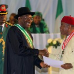 HE T.A Orji receiving the CON award from the President of the Federal Republic of Nigeria, Goodluck Jonathan