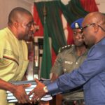 Governor Okezie Ikpeazu receiving the report for the PDP Southeast 2015 elections performance from Chief Ndindi Okereke