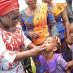 The wife of the Governor, Mrs Nkechi Ikpeazu deworming school children at Isiala Ngwa North.